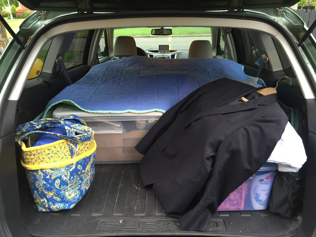 backend of car loaded with clothes for a trip